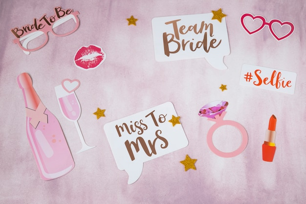 On pink background stickers for hen party: ring, champagne, stickers