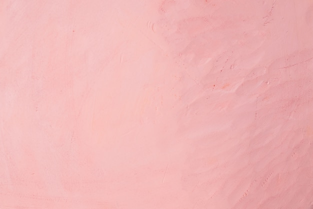 Pink background, wall cement texture. strokes of concrete .