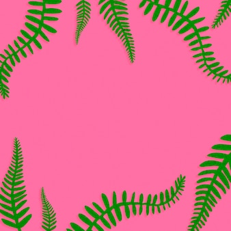 Pink background with green leaves