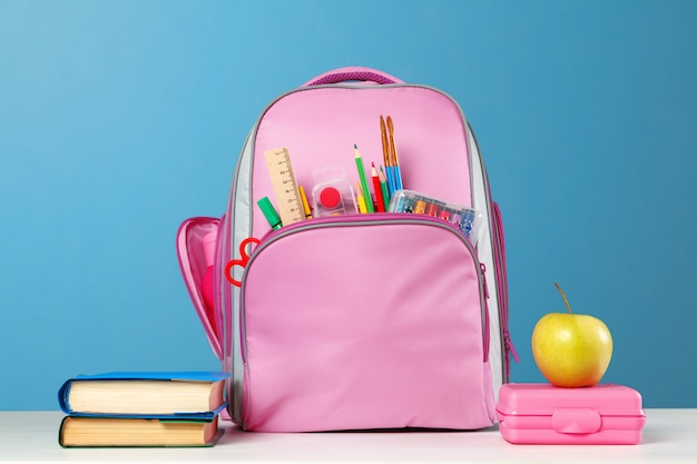 Pink backpack with stationery objects