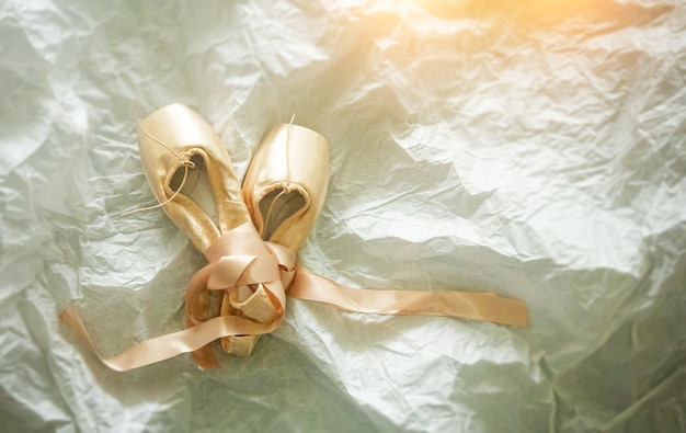The pink ballet shoes on grunge surface background