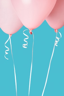 Pink balloons on blue background