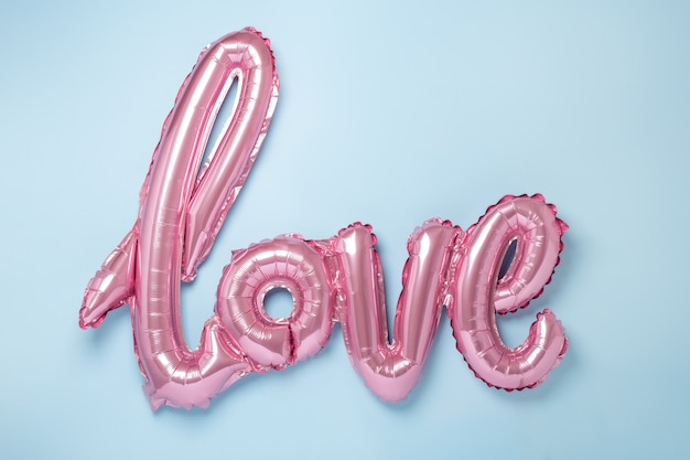 Pink balloons in the form of word love