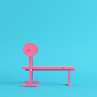 ベンチ明るい青色の背景とピンクのバーベル