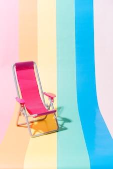 Розовый шезлонг на разноцветном фоне концепция путешествий и лета иллюстрация 3d копией пространства