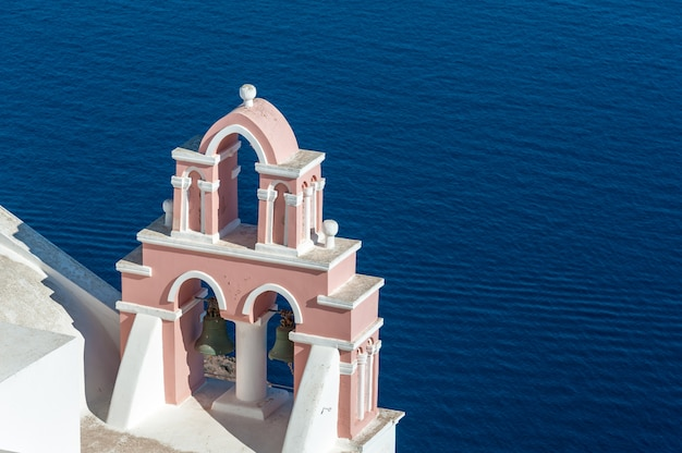 Pink bell tower over the sea
