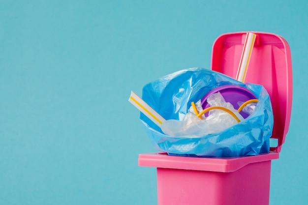 Pink big trash on blue background