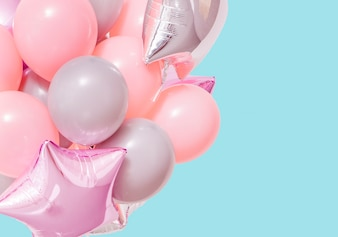 Pink birthday air balloons on mint background with mockup