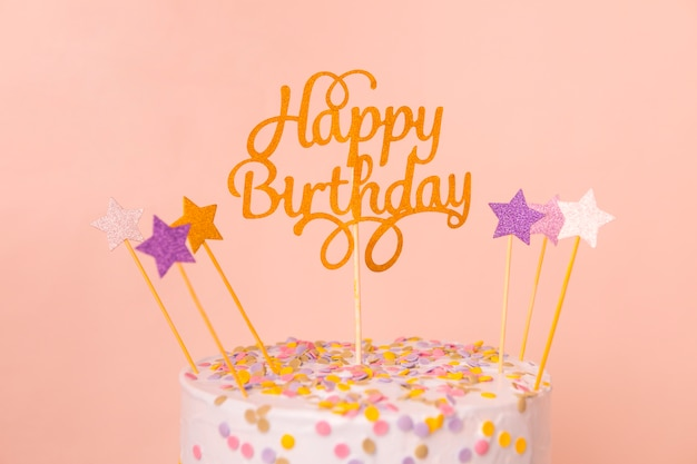 Pink birthday cake with topper