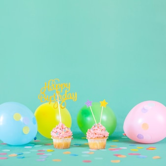 Pink birthday cupcakes with balloons