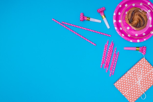 Pink birthday items on blue background