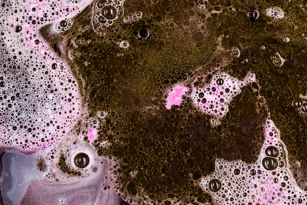 Pink and black suds mixing