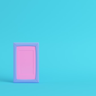 Pink blank frame on bright blue background