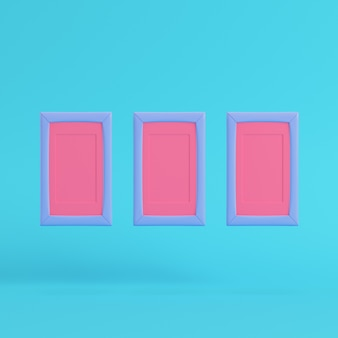 Pink blank frames on bright blue background