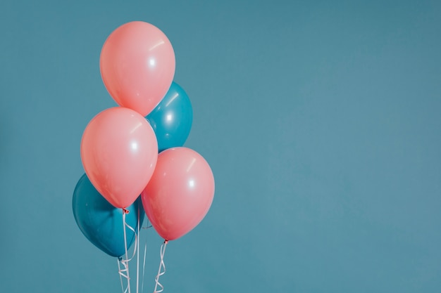 Pink and blue helium balloons