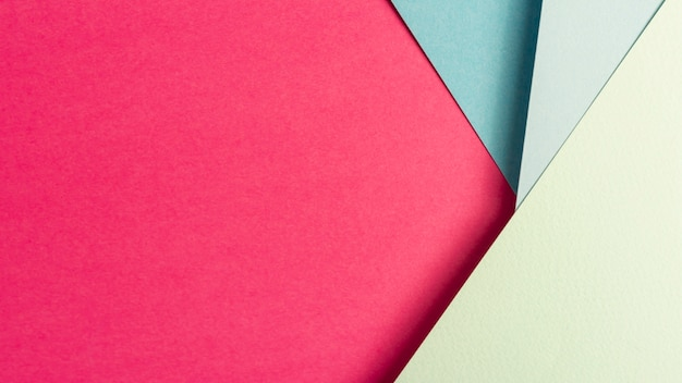 Pink and blue paper sheets with copy space