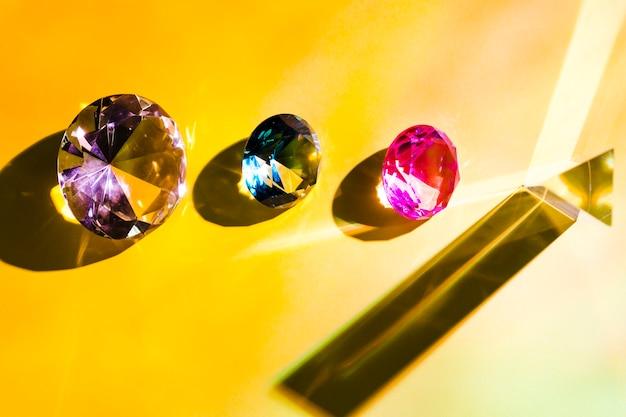 Pink; blue; purple and yellow triangular diamond on yellow background