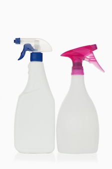 Pink and blue spray bottles