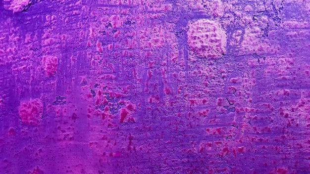 Розовая синяя текстура для фона. нежная классическая текстура. красочный фон красочная стена. фрагмент каменной стены с красочными знаками и освещением краской. фон с копией пространства.