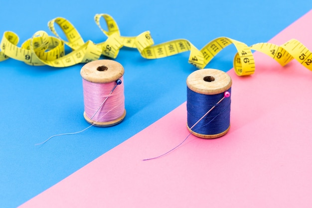 Pink and blue threads contrasting with a reverse colored background