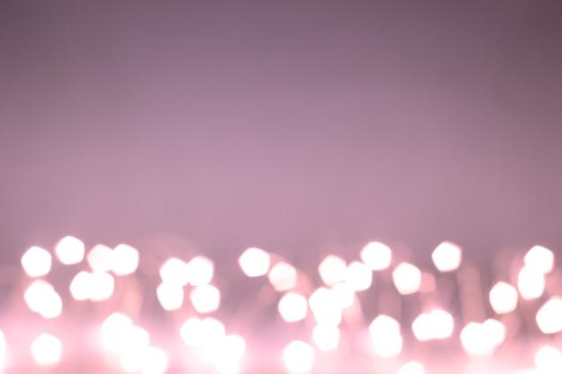 핑크 보케 효과입니다. 화환. 공간을 복사합니다. 화환. 단색 배경에 핑크 조명입니다.