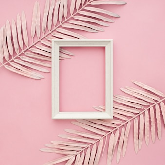 Pink border leaves on pink background with blank frame