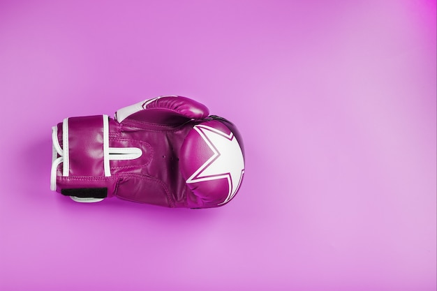 Pink boxing gloves on a pink background, free space