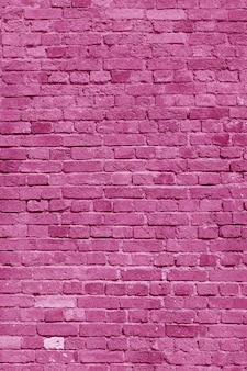 Розовая кирпичная стена. лофт дизайн интерьера. розовая краска для фасада. архитектурный фон.