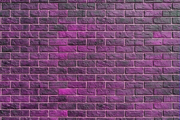Pink brick wall. modern construction industry. building's facade.