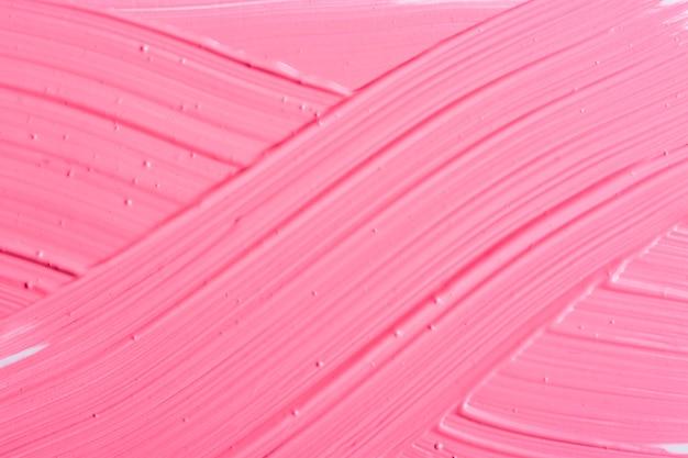 ピンクのブラシストロークテクスチャ背景