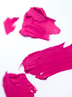 Pink brush strokes on white background