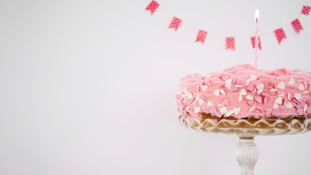 Pink cake decorated with candle