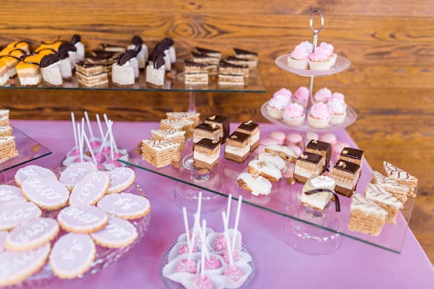 Pink candy bar served with delicious chocolate and cream sweets