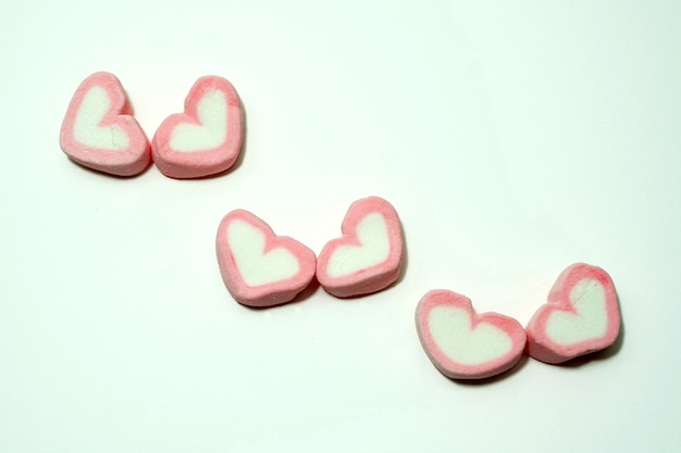 Pink candy hearts for valentines day on white background
