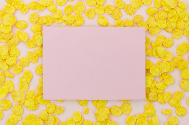 Pink card surrounded by cornflakes