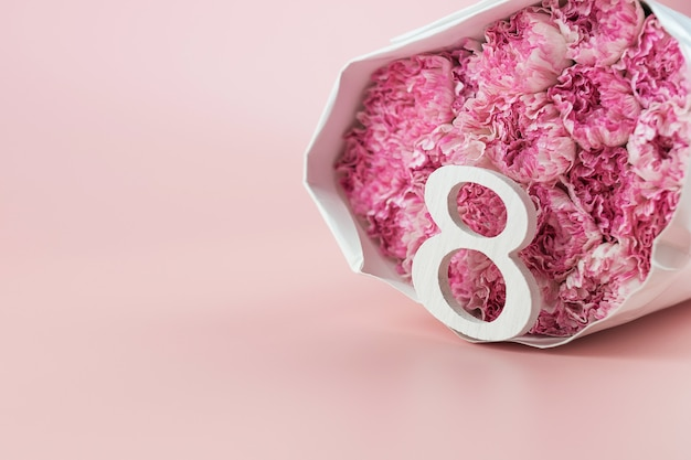 Pink carnation flower and 8th march calendar with copy space for text. love, equal and international women day concept