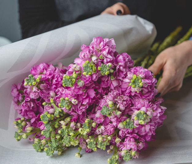 Pink carnations wrapping as a bouquet