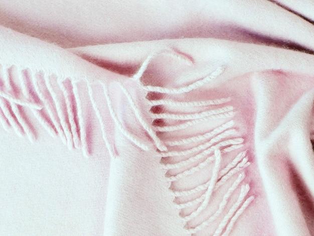 Розовая текстура кашемировой ткани натуральная шерсть драпируется вид сверху концепция зимнего и осеннего комфорта