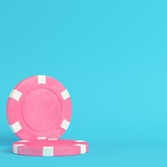 Pink casino chips on bright blue background