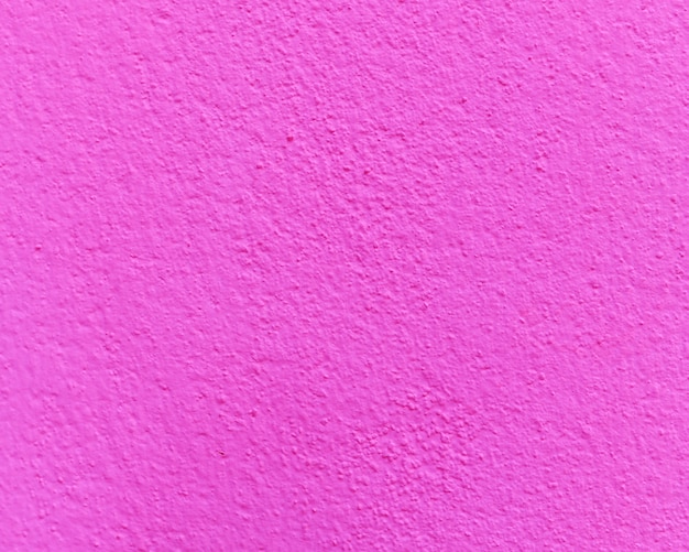 Pink cement or concrete wall texture for background.