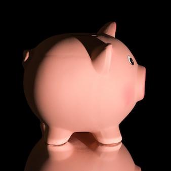 Pink ceramic piggy bank, isolated on blackbackground