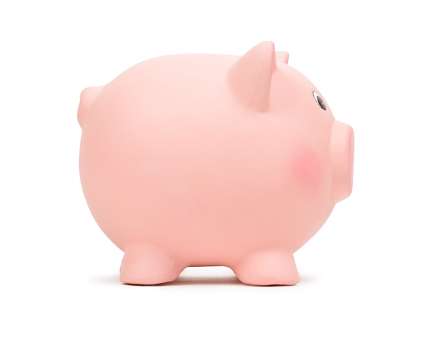 Pink ceramic piggy bank, isolated on white.