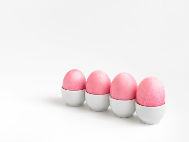 Pink chicken eggs on a white background. minimalism. easter composition.