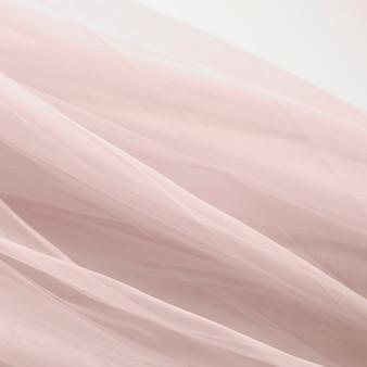Розовая шифоновая ткань текстуры фона