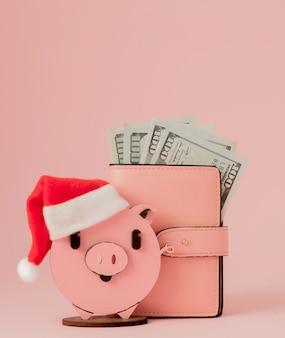 ピンクのクリスマス豚とドルの財布