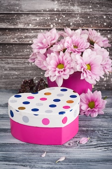 Pink chrysanthemum in concrete pot