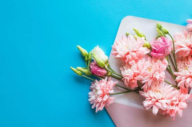 Pink chrysanthemum flowers and ranunculus flowers, gift or present, envelope