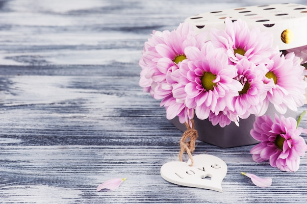 Pink chrysanthemum in gift box and heart