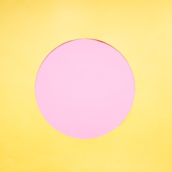 Pink circle on yellow background