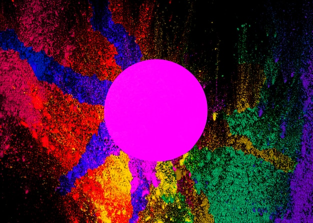 Pink circular frame on dry holi powder over the black background